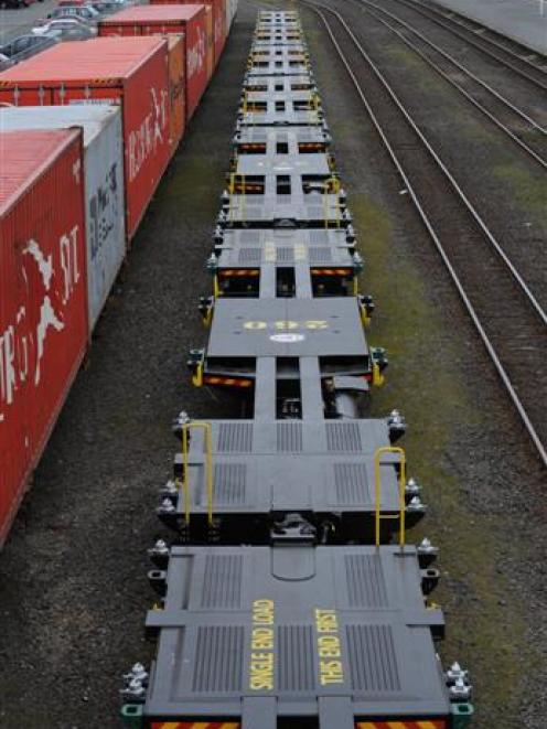 A row of new rail wagons, capable of carrying up to 72 tonnes of cargo, sits at the Dunedin...