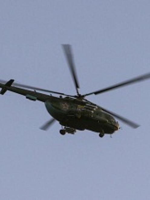 A Russian military helicopter flies over Crimea. REUTERS/Baz Ratner