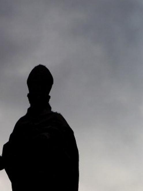 A scuplture of a Saint on the St. Peter's colonnade in Vatican City.  Photo Getty Images