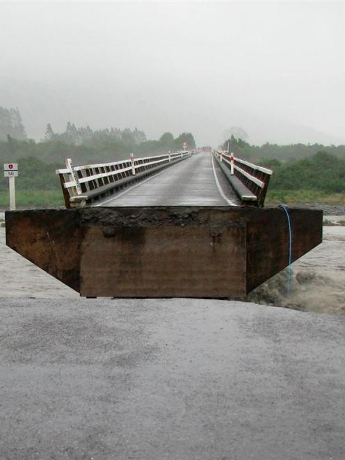 A section of the Wanganui River bridge, near Harihari, on the West Coast, which was swept away by...