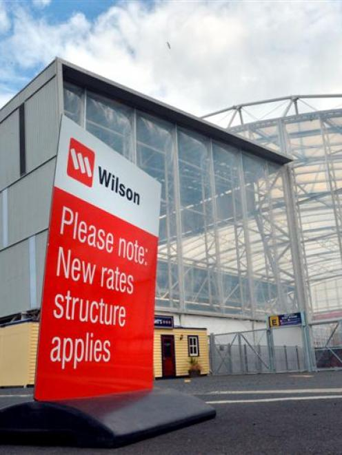 A sign announces the introduction of charges for parking cars outside Forsyth Barr Stadium. Photo...