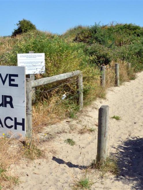 A sign erected by locals at Te Rauone, where erosion is affecting a council reserve.