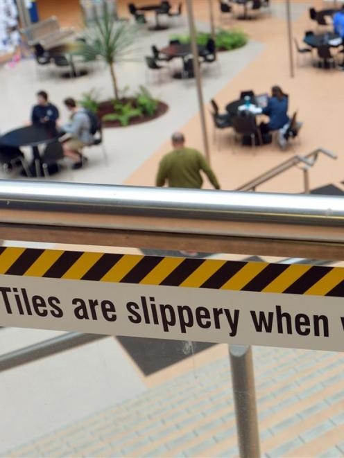 A sign warns of the slippery floor in the University of Otago commerce building. Photo by Stephen...