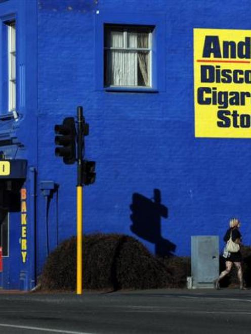 A sign on Andy's Milk Bar in Mosgiel yesterday, which is illegal under the new smoke-free...