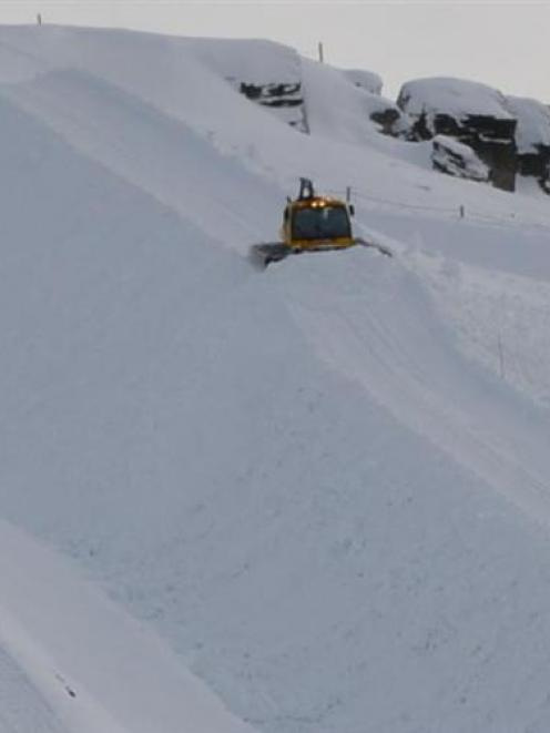 A snow-groomer is used to form the Cardrona halfpipe this week. Photo by Hamish Rudhall.