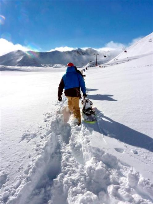 A snowboarder hikes in the new snow at the Remarkables. Photo by Wendy van Dijk.