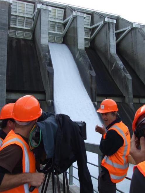 A spillway is opened at the Clyde Dam yesterday for a television documentary about New Zealand...
