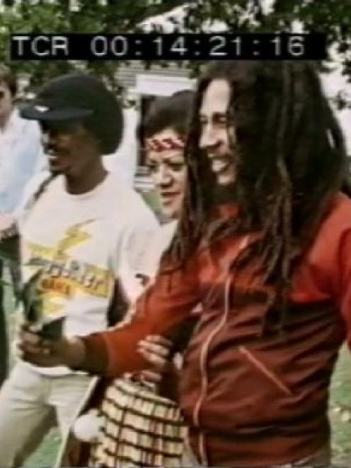 A still from documentary Come a Long Way showing Bob Marley receiving a powhiri at Parnell