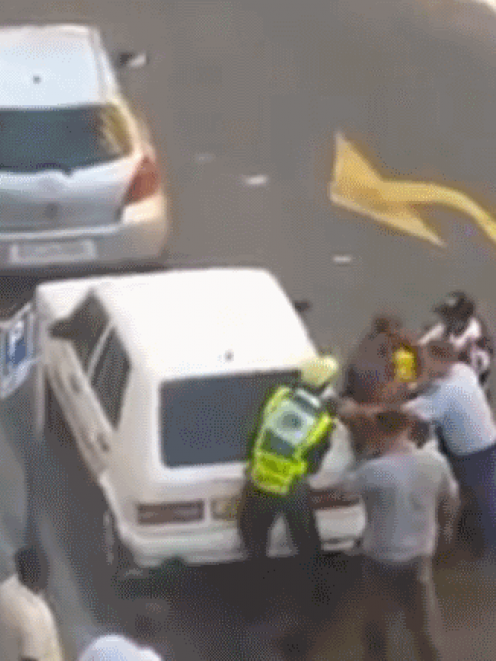 A still from the video which shows two police officers assaulting a man suspected of robbery in...