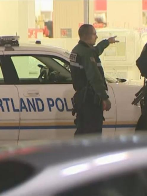 A still image taken from video courtesy of KATU-TV shows Portland police officers responding to a...