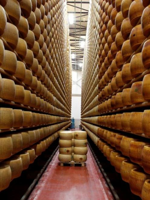 A storage area for Parmesan cheese wheels is pictured at a warehouse owned by Credito Emiliano...