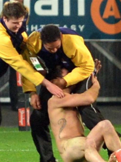 A Streaker during the 2014 Allblack and England rugby Test at the Forsyth Barr Stadium on...