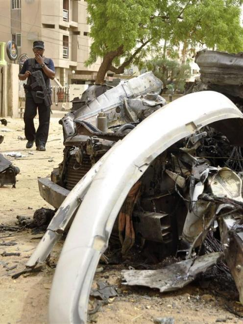 A suicide car bomber killed five people on a street of bars and restaurants in the northern...