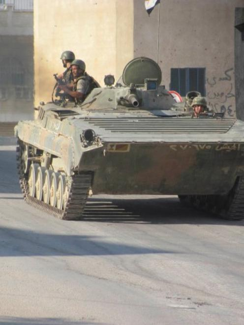 A tank belonging to forces loyal to Syria's President Bashar al-Assad is seen in Deraa yesterday....
