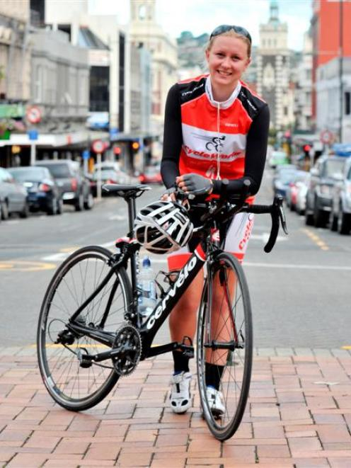 A tired Irene Le Fleming (19), of Waimate, leans on her bike in Dunedin's Octagon yesterday,...