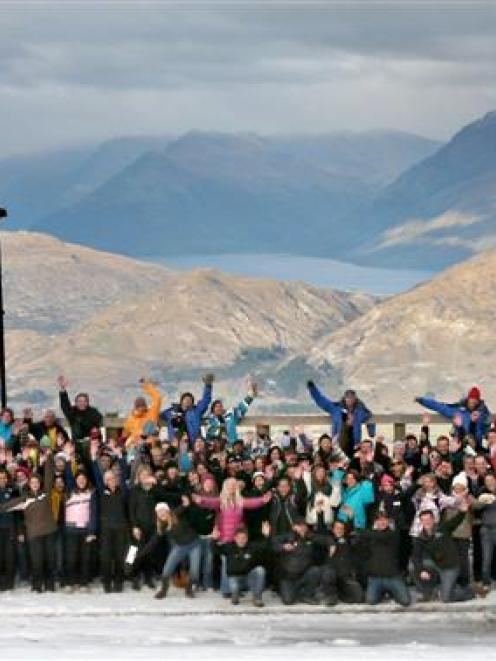 A total of 240 staff take time out from preparing for the 2011 ski season   to pose for a photo...