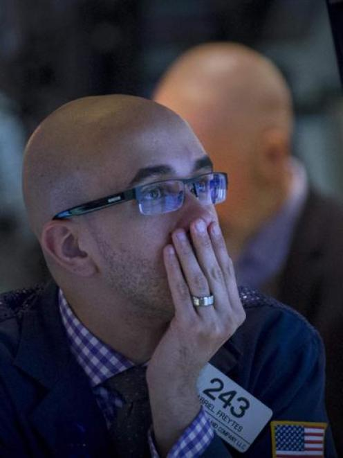 A trader works on the floor of the New York Stock Exchange earlier this month. Photo by Reuters..