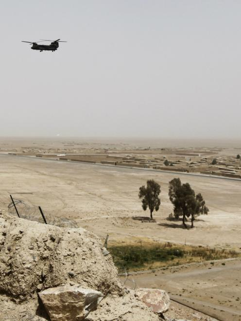 A US Chinook helicopter flies over the border area between Afghanistan and Pakistan. (REUTERS...