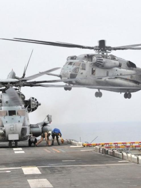 A US helicopter takes off from the USS Bonhomme Richard LHD 6 in the sea off Pohang yesterday....
