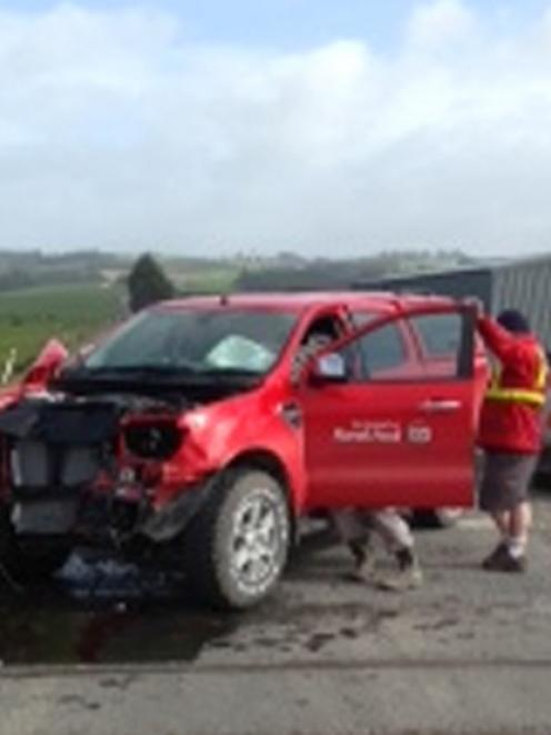 A ute after it crashed into a locomotive at a level crossing near Milburn yesterday morning....