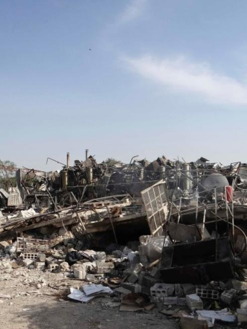 A view shows buildings destroyed by what activists say were missiles fired by a Syrian Air Force...