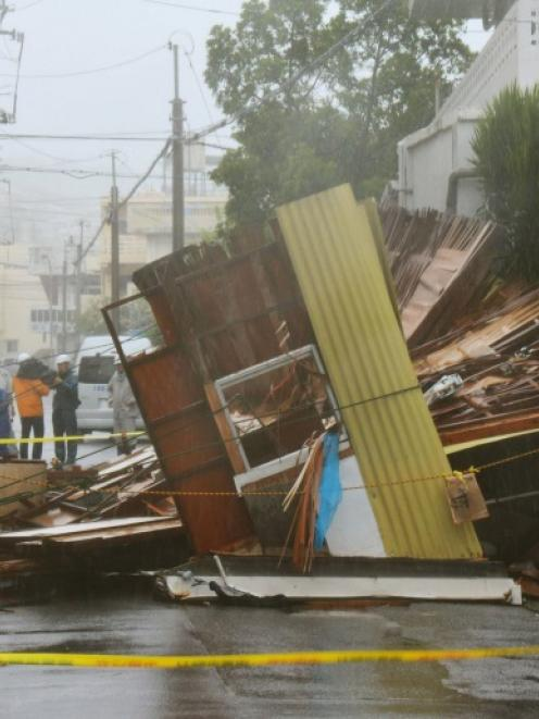 A wooden house which collapsed due to strong winds caused by Typhoon Neoguri is seen in Naha, on...