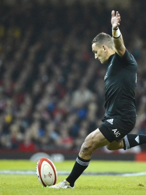 Aaron Cruden of New Zealand kicks a penalty during their international rugby union match against...