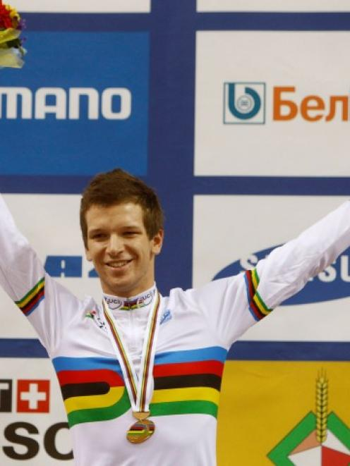Aaron Gate poses for a photo with the gold medal after the men's omnium final at the 2013 UCI...