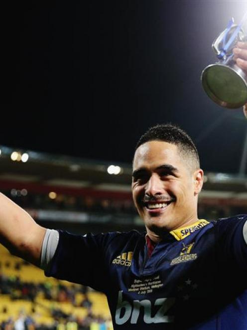 Aaron Smith celebrates after winning the 2015 Super Rugby championship with the Highlanders,...