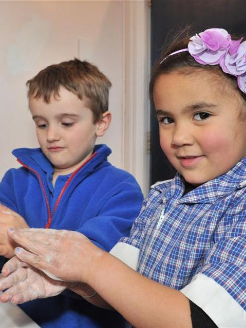 Abbotsford School pupils Harry Bond (left) and Layla Barton  (both 5) wash their hands in a bid...