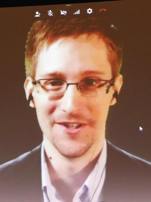 Accused US government whistleblower Edward Snowden is introduced to supporters of Amnesty...