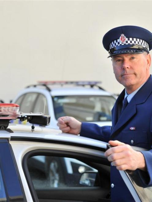 Acting Southern district road policing manager Senior Sergeant Steve Larking stands next to the...