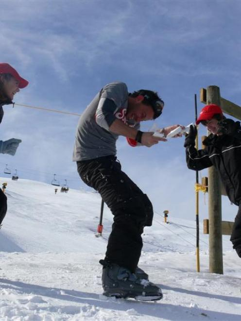 Actor Craig Parker (centre) awaits the next snowball from Aucklanders Danielle van der Heijden ...
