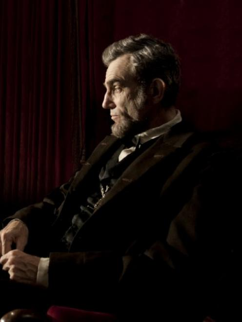Actor Daniel Day-Lewis portrays United States president Abraham Lincoln in a scene from director...