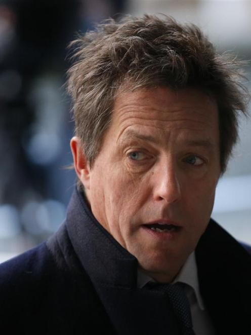 Actor Hugh Grant will donate his damages to pressure group 'Hacked Off'.   REUTERS/Andrew Winning
