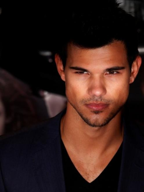 Actor Taylor Lautner arrives for the European premiere of 'The Twilight Saga: Breaking Dawn Part...