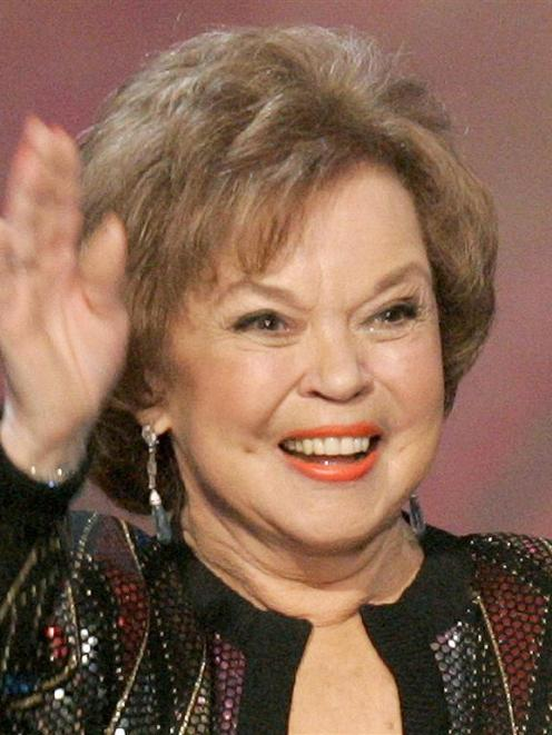 Actress Shirley Temple Black waves as she accepts the Screen Actors Guild Life Achievement Award...