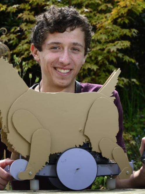 Adam Gorrie shows off his remote-controlled Cairn terrier, which has starred in a play and won a...