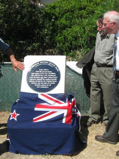 Admiring the new plaque outside the old doctor's residence in Kurow are, from left, Jim Meehan,...