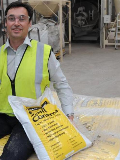Adveco general manager New Zealand Andrew Protheroe with a lump of raw material and some bagged...