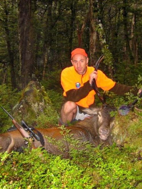 Hunter Safety Lab Ltd founder and chief executive Michael Scott with a deer in the Nelson Lakes,...