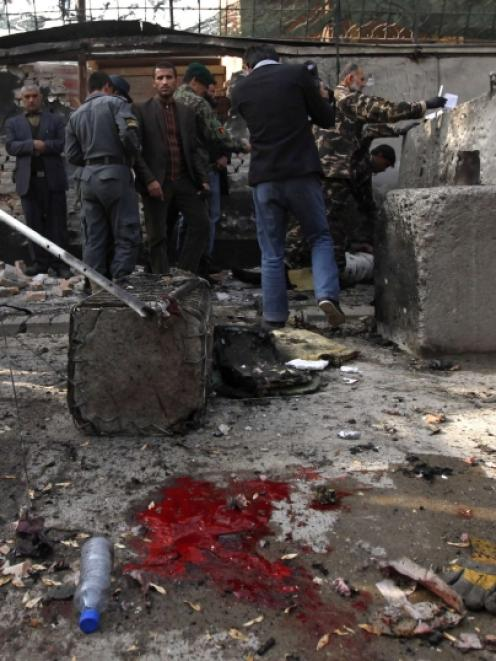 Afghan security personnel investigate at the site of a suicide attack in Kabul. Photo by Reuters