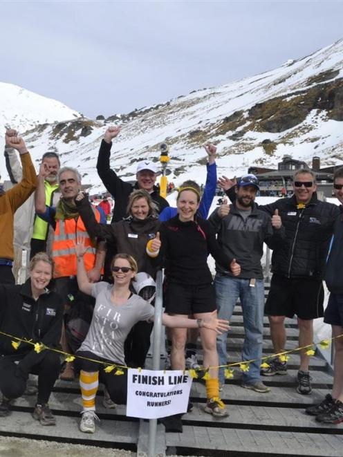 After running up the access road to the Remarkables skifield in aid of Daffodil Day, staff pose...