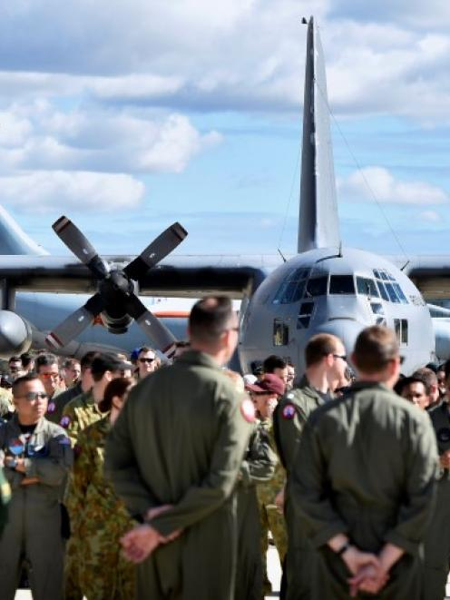 Air crews involved in the search for MH370 prepare for an official photograph on the tarmac at...