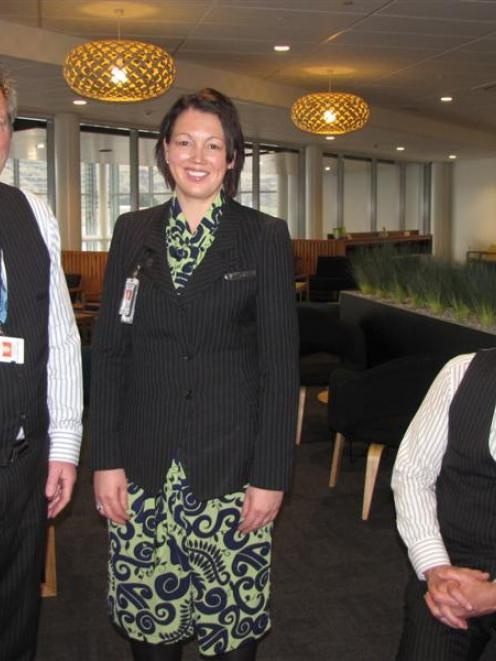 Air New Zealand airport manager Dave Whitaker (left) with Air New Zealand Koru Lounge concierges...