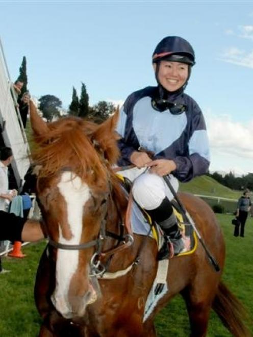 Akane Yamamoto, the Japanese rider, returns to scale after her first New Zealand win on Ambaarun...
