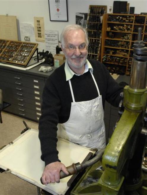Alan Loney uses an Albion handpress during his time as printer in residence at the University of...
