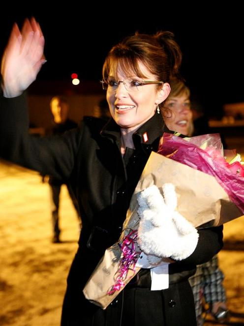 Alaska Gov. Sarah Palin greets supporters after returning to Anchorage, Alaska, on Wednesday Nov....