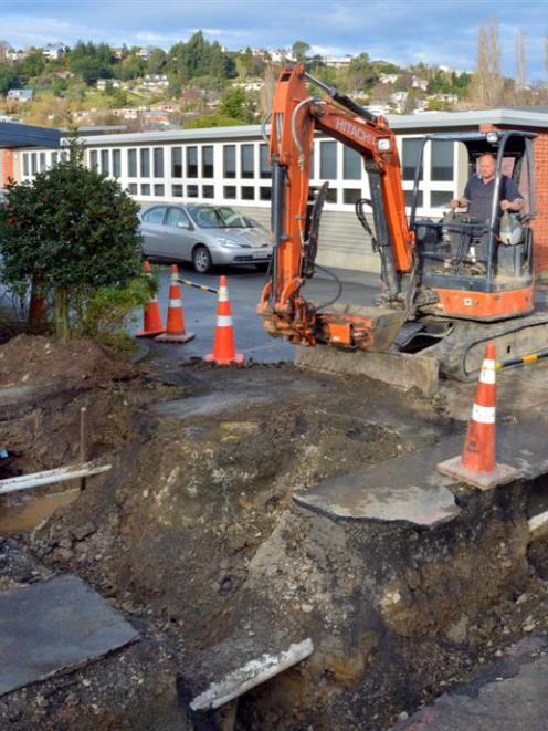 Alastair Bowen, of Island Park Contractors, digs a hole at Dunedin's Kaikorai Valley College, in...