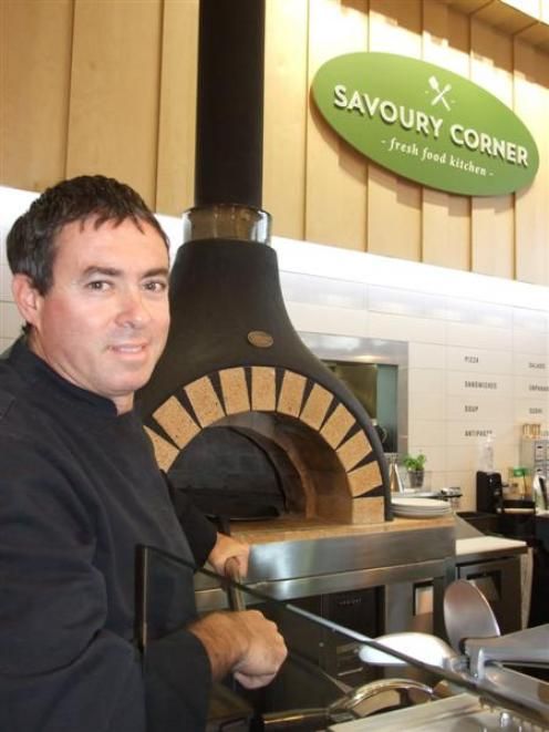 Alex Giminez, co-owner of Patagonia Chocolates and now Savoury Corner, with the new cafe's pizza...